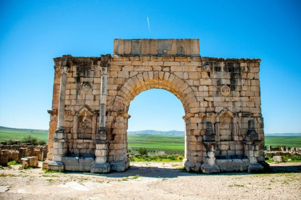 Seeing the triumphal arch at the ruins of Volubilis is one of the interesting things to do in Morocco