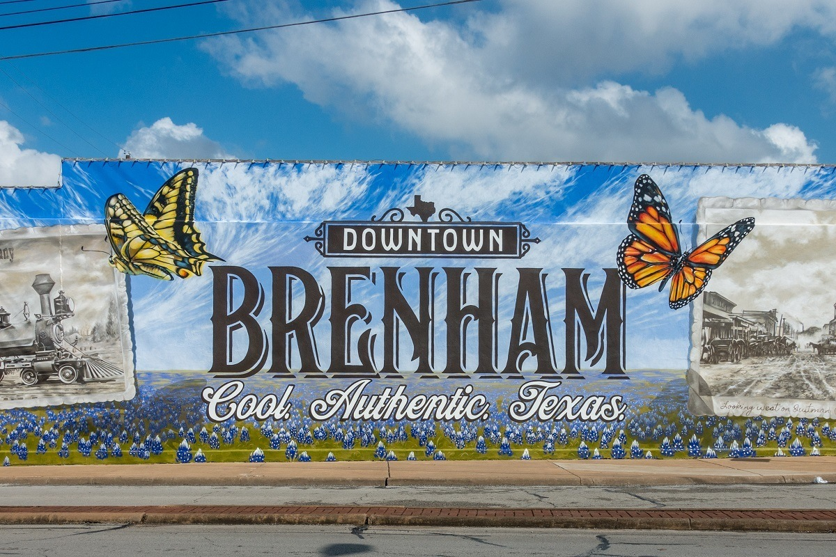 "Butterfly mural labeled ""Downtown Brenham: Cool. Authentic. Texas"""