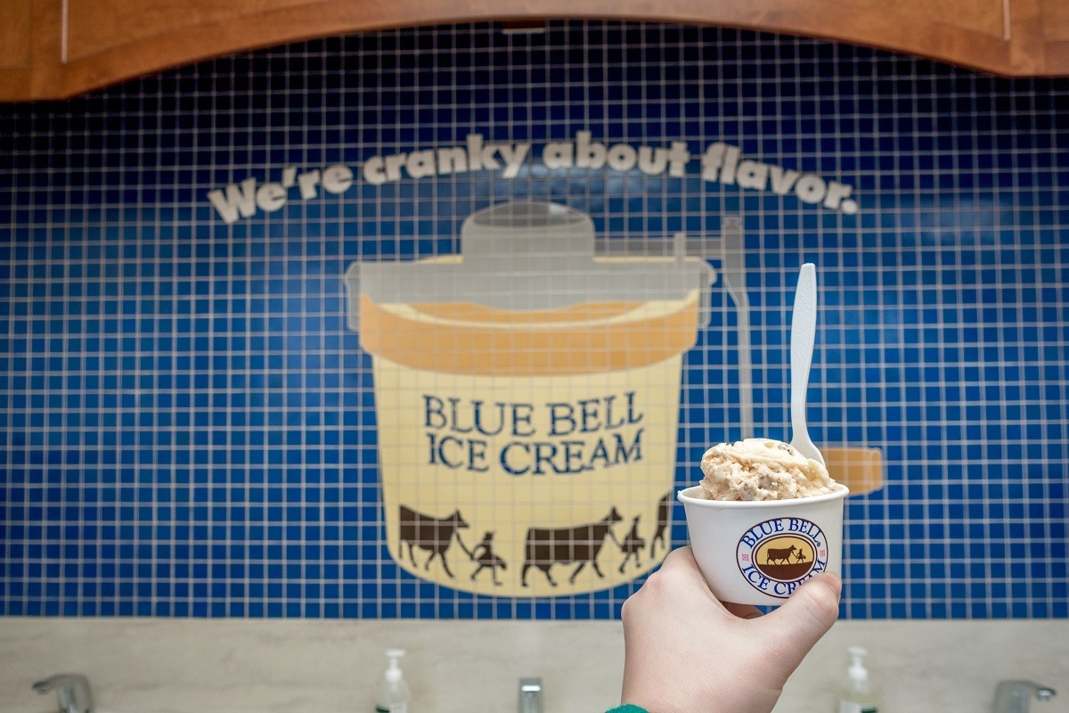 Ice cream cup in front of mosaic at Blue Bell ice cream factory in Brenham