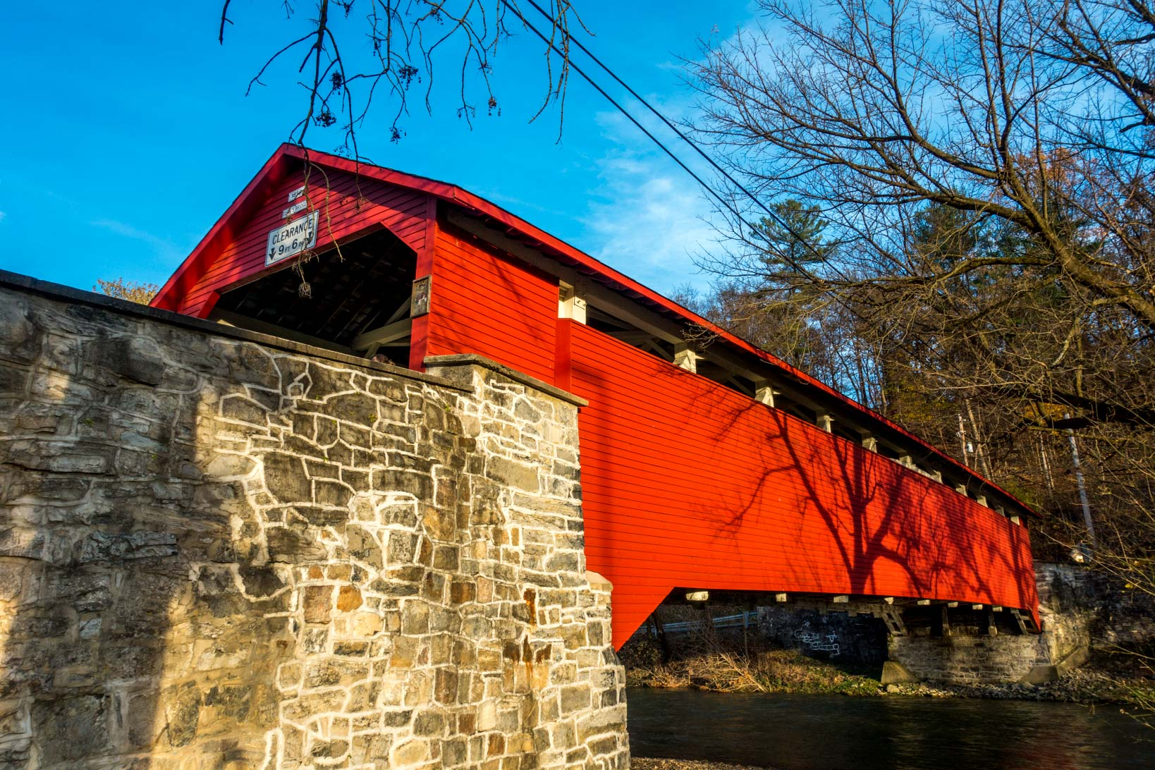 Exploring a red covered bridge in Allentown, PA on a covered bridge tour