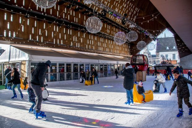 Ice skating at the city pavilion in winter is a highlight of Ghent travel