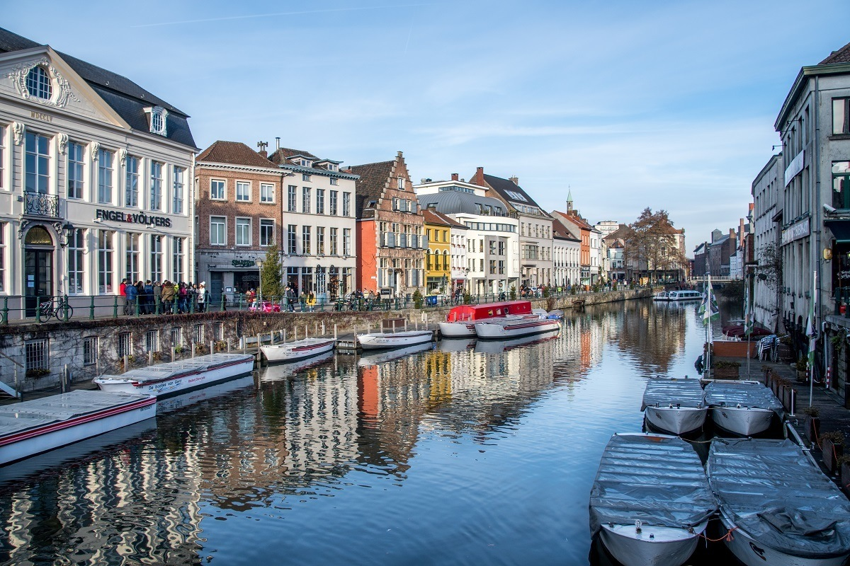 Buildings along Lys River with boats in Ghent Belgium