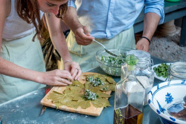 Making stuffed grape leaves at a cooking class is one of the fun activities in crete