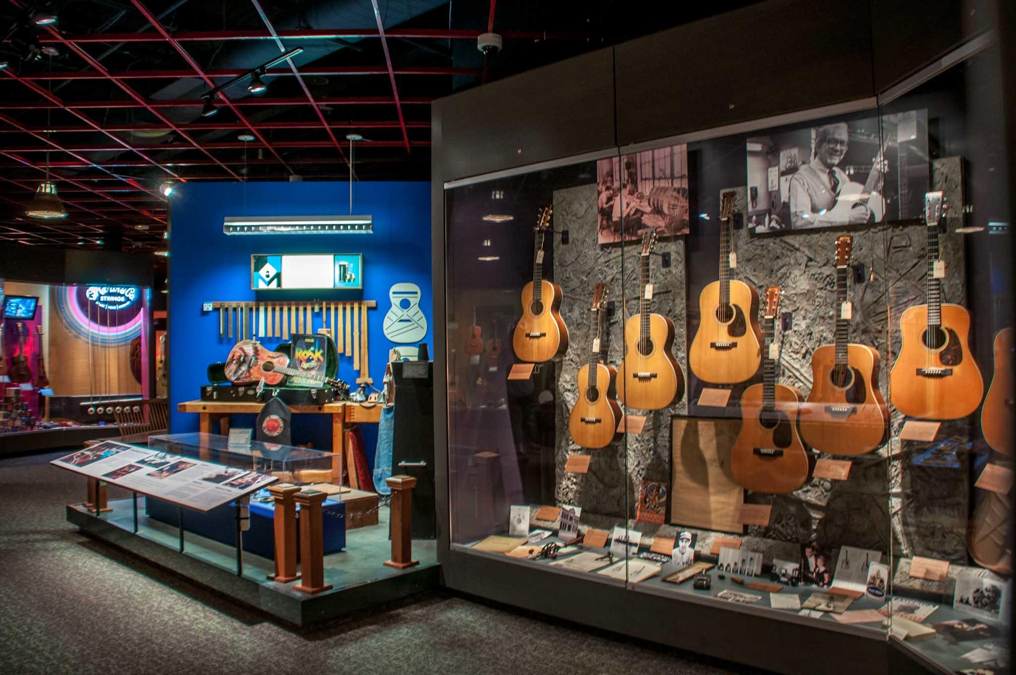 Glass case of guitars in the memorabilia room at the Martin Guitar Factory