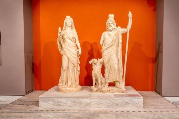 Statues of Persephone, Cerberus, and Pluto at Heraklion Archaeological Museum, a highlight of Crete sightseeing