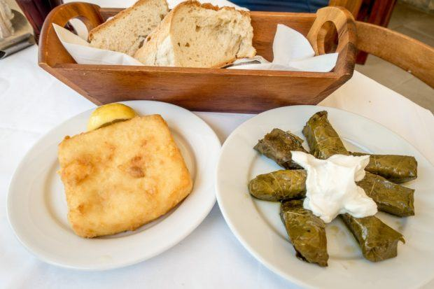 Stuffed grape leaves and saganaki cheese are must-try foods in Crete