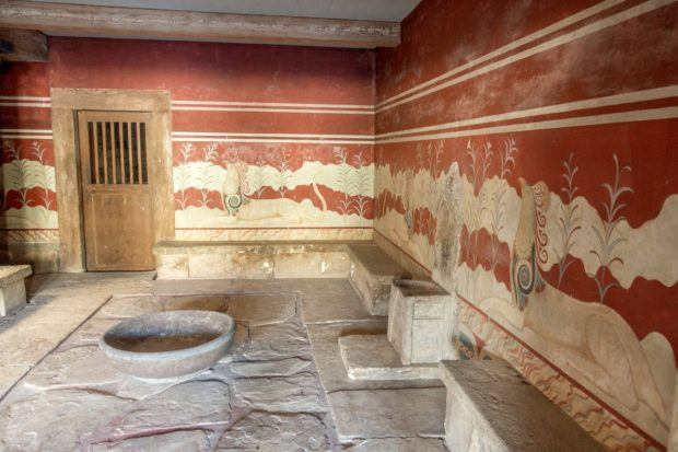 The throne room at the Minoan Palace of Knossos, which is one of the top attractions in Crete Grecee