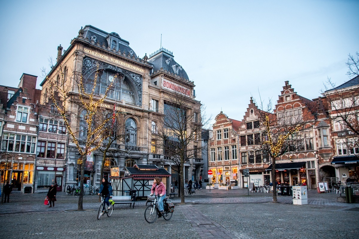 People on bicycles in Ghent city square, Vrijdagmarkt