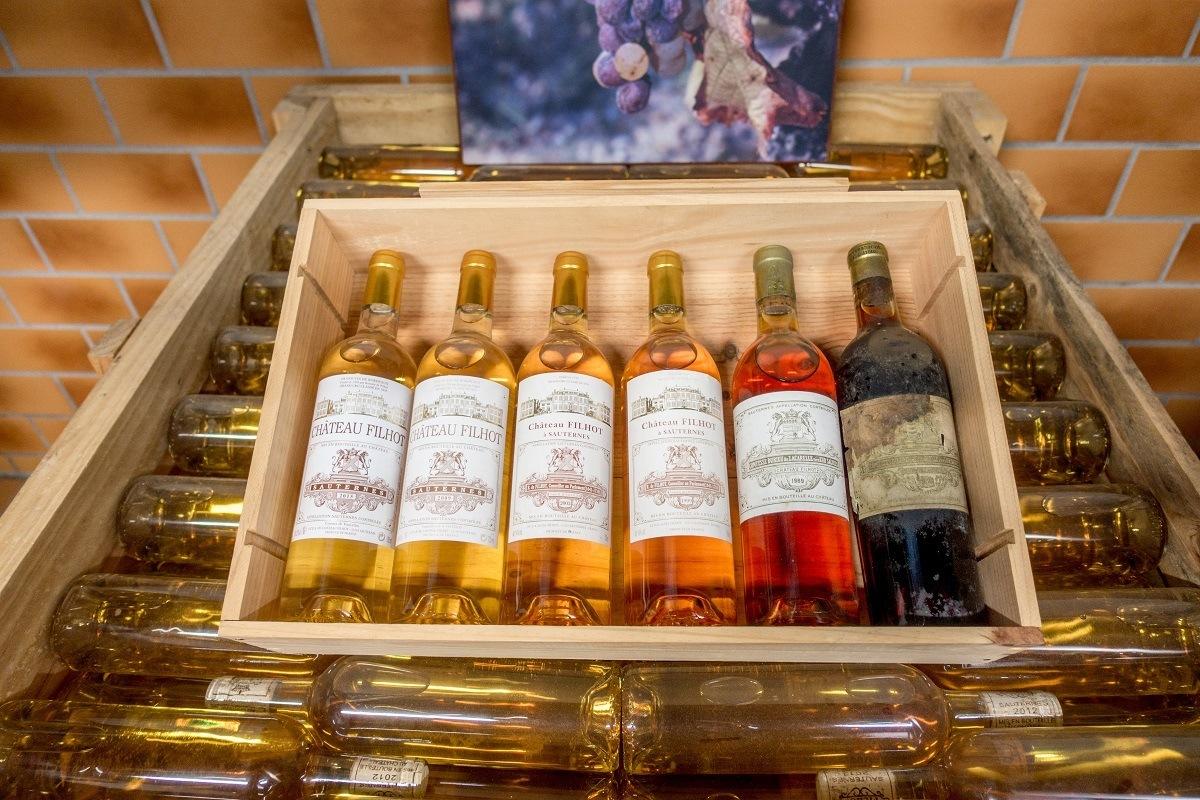 Bottles of different vintages of Chateau Filhot Sauternes on display