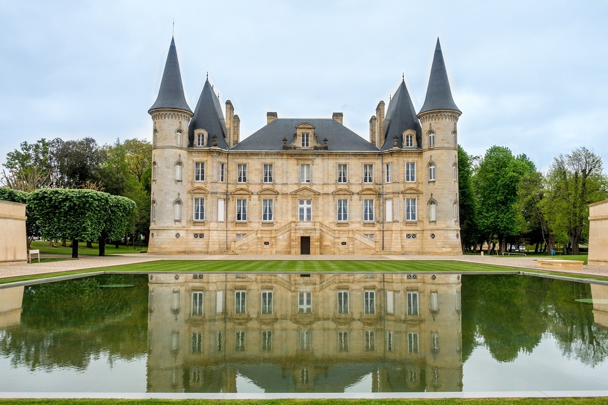 Castle-like building and reflecting pool at Chateau Pichon Baron