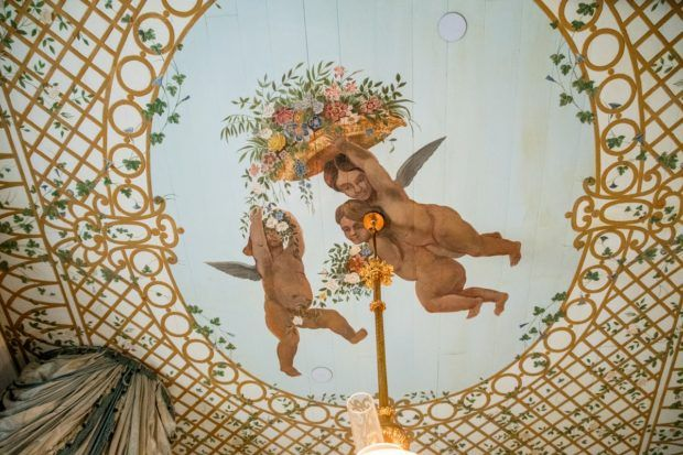 Ceiling hand painted with cherub decoration at San Francisco Plantation near New Orleans Louisiana