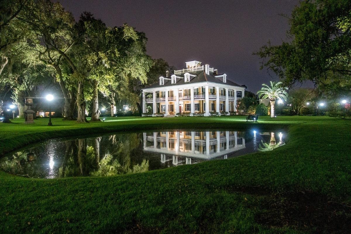 Houmas House mansion lit up at night