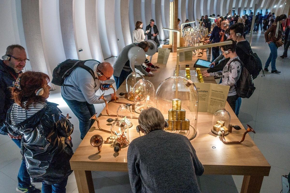 Visitors smelling wine aromas at La Cite du Vin, Bordeaux's wine museum