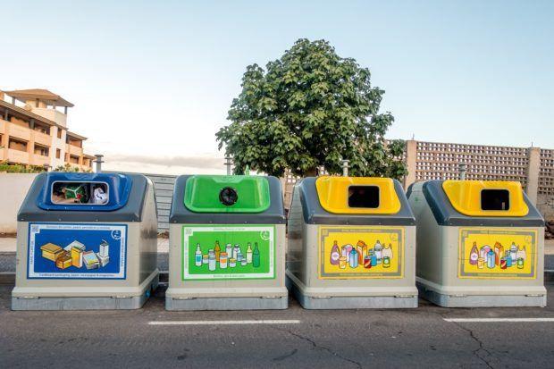 An easy way how to go green--put the recycling in the proper bins