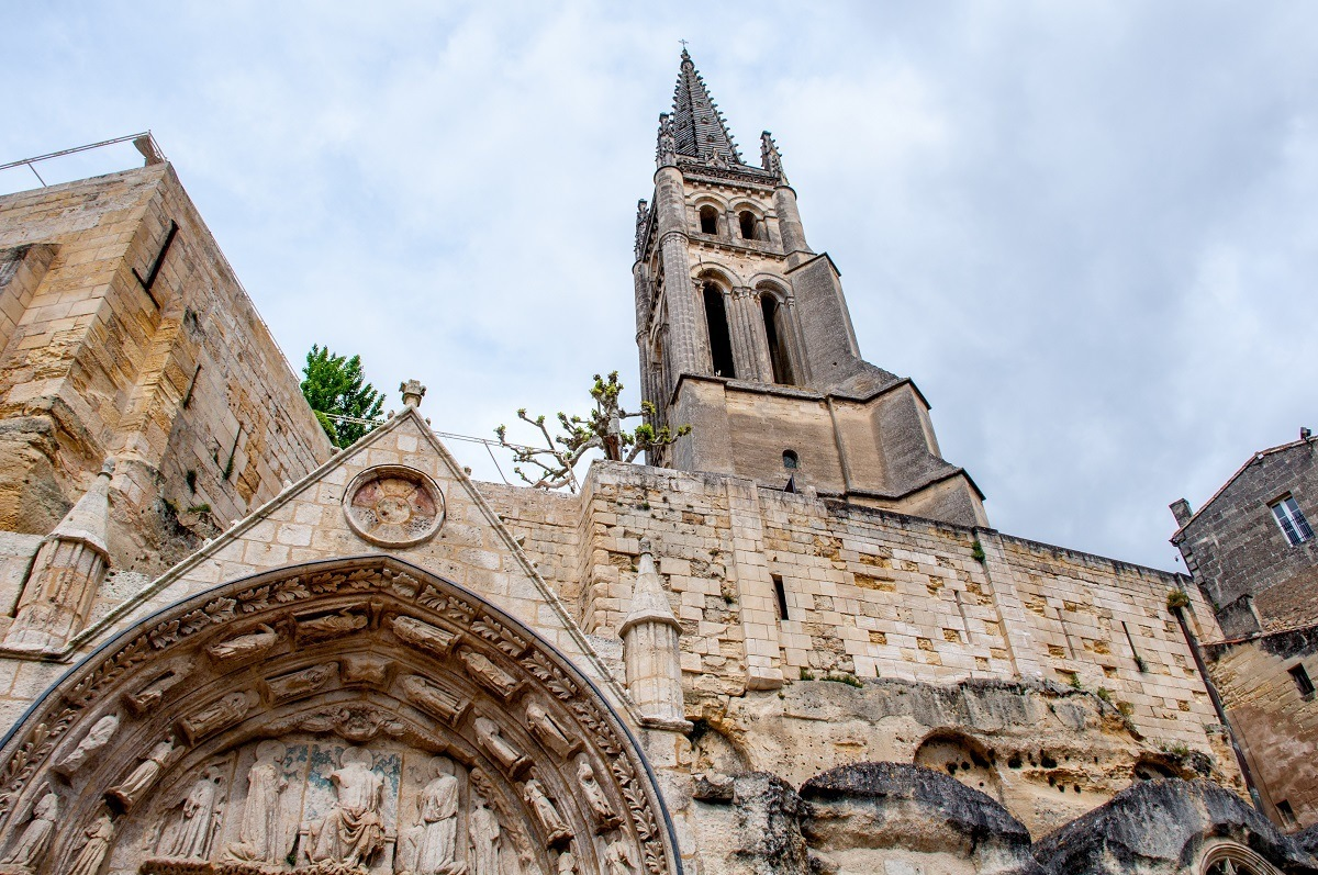 Stone exterior and bell tower of the Monolithic Church in St Emilion