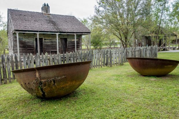 Slaves quarters and sugar kettles at Whitney Plantation near New Orleans, Louisiana. A stop here should be on your New Orleans itinerary 3 days