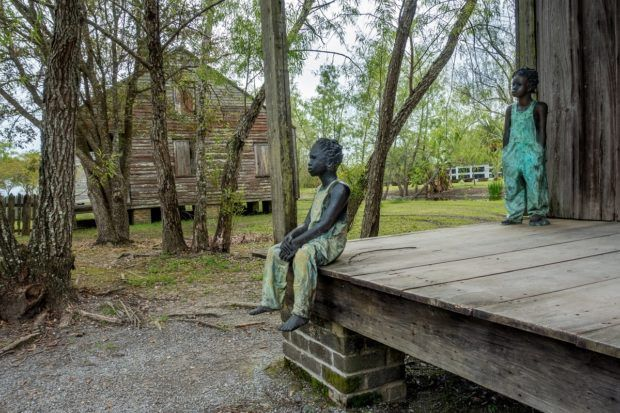 Children of Whitney--clay statues representing child slaves--at former slave quarters are a moving tribute at Whitney Plantation, a plantation in New Orleans area