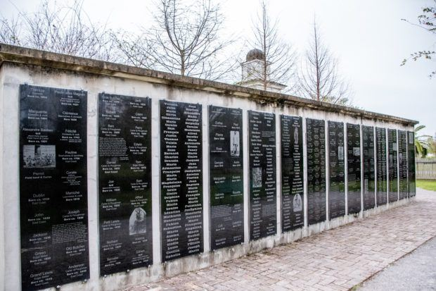 The black granite Wall of Honor has the names and information about over 300 enslaved people at the Whitney Plantation New Orleans
