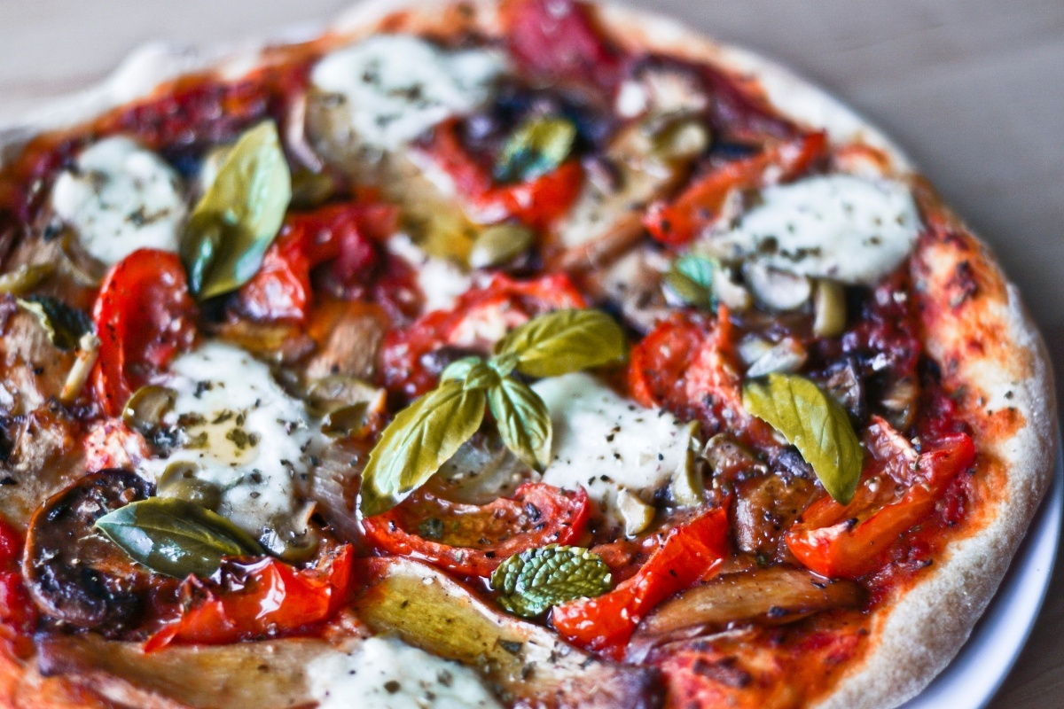 Gozitan ftira, traditional bread topped with cheese and vegetables, is very much like pizza an is a popular Maltese food