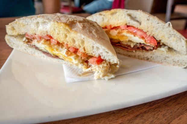 Traditional ftira bread used in a breakfast sandwich with egg and bacon | ftira Malta