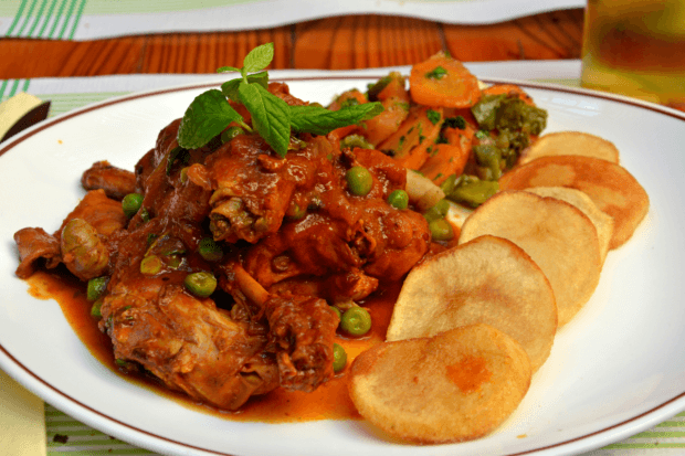 Stewed Maltese rabbit served with fired potatoes and vegetables