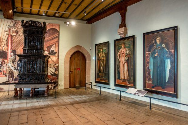 Paintings of emperors line the walls inside the Imperial Castle, one of the top places to visit in Nuremberg Germany