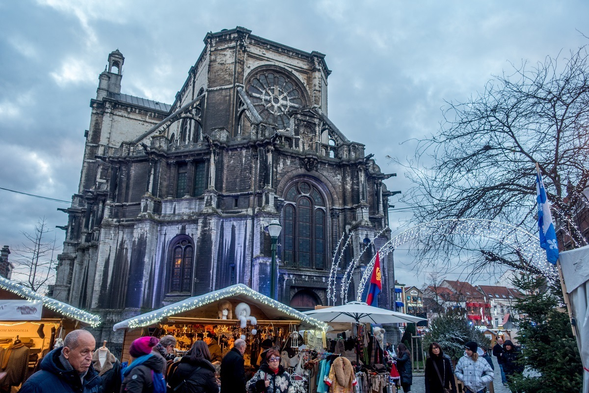 Chalets selling food and gifts behind St. Catherine's Church in Brussels Belgium