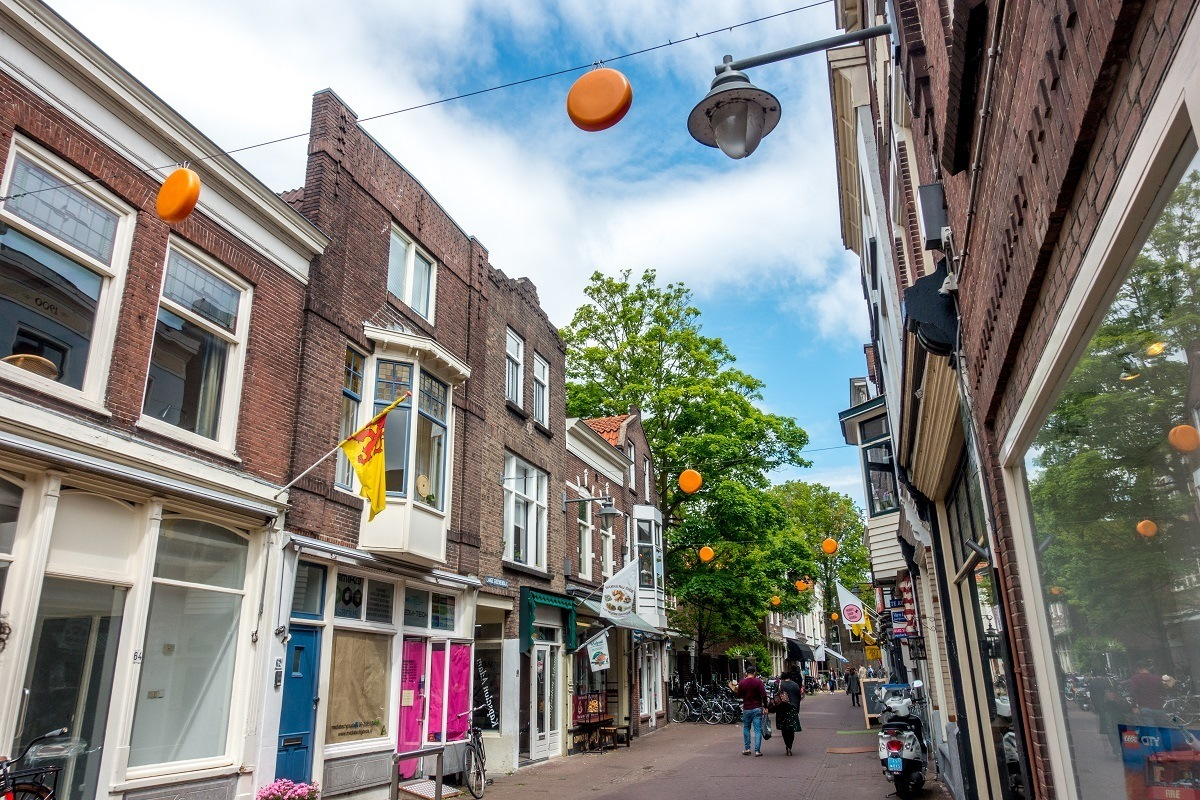 Cheese wheels hanging across the streets welcome visitors to Gouda in South Holland, Netherlands
