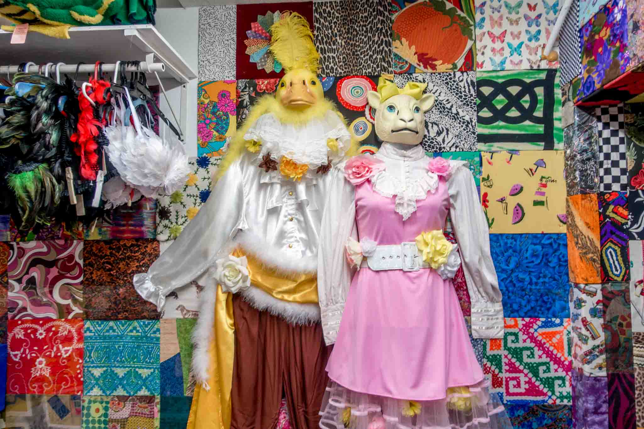 Mannequins wearing costumes and animal masks