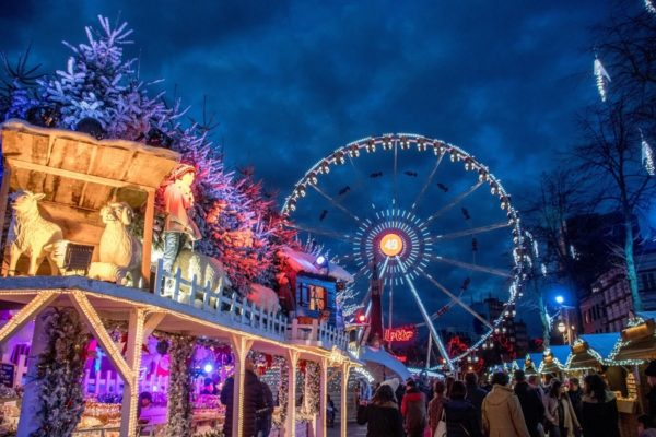 Christmas markets in Belgium have beautifully decorated stalls selling gifts and food along with carnival games and rides like the Ferris wheel