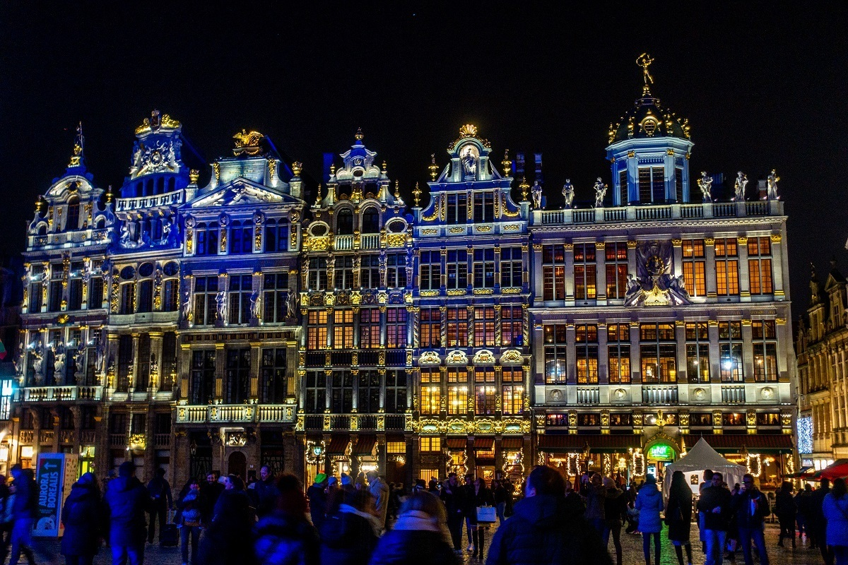 Crowd watching light show on the buildings of Brussels main square