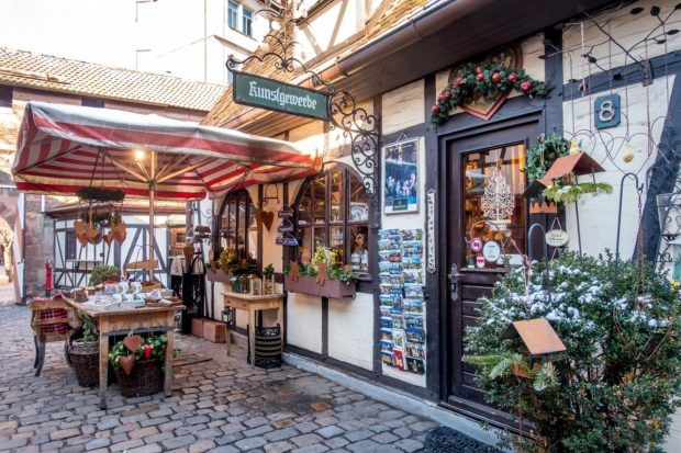 A traditional-looking half-timbered craft shop in Handwererkhof, one of the tourist attractions in Nuremberg that showcases craftsmanship