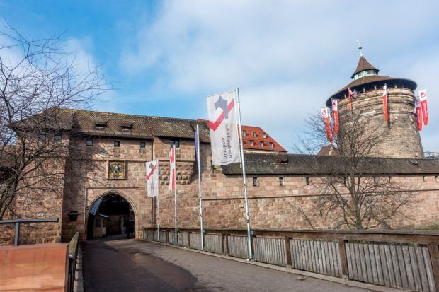 One of the old city walls and towers marks the edge of the historic center of Nuremberg and the entrance to the craft area, Handwerkhof