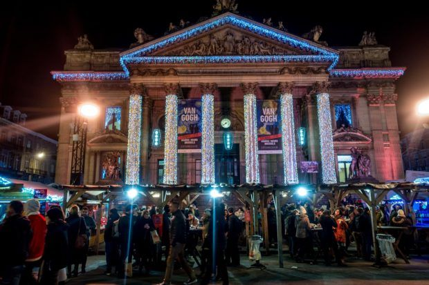 The Bourse lit up for the Brussels market, one of the best Christmas markets in Belgium