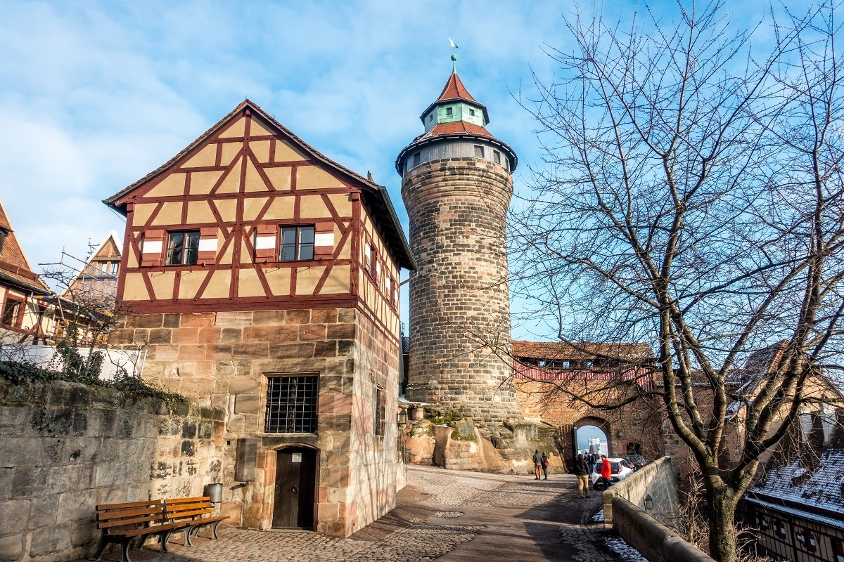 The round Sinwell Tower and the half-timbered Deep Well building are two parts of the Imperial Castle in Nuremberg that were not destroyed during World War II