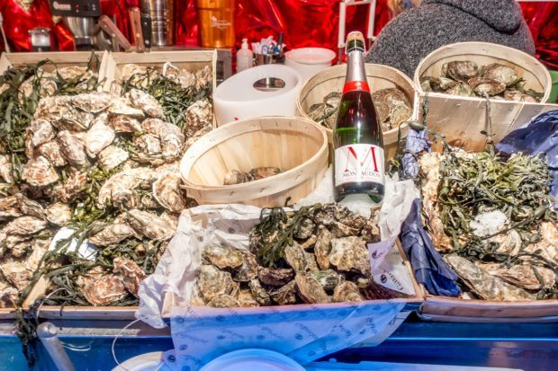 Oysters on a table awaiting buyers -- a delicacy in Brussels at Christmas