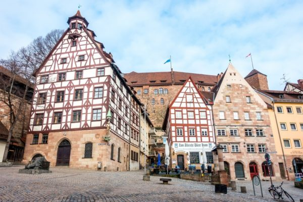 Visiting Platz am Tiergärtnertor, a square of bright half-timbered buildings, is one of the unique things to do in Nuremberg Germany