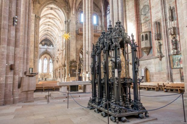 The ornate brass tomb of Sebaldus sits in the middle of St. Sebald Church in Nuremberg Germany