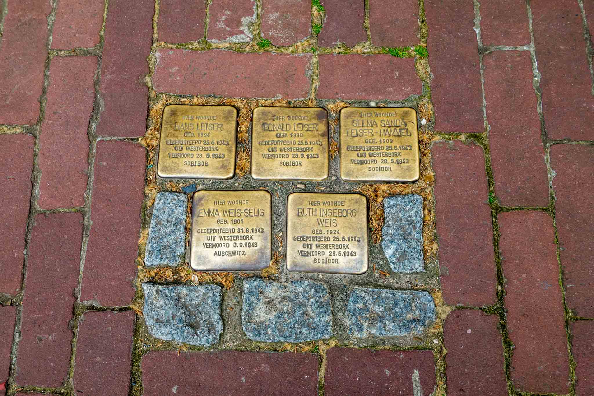 Stolpersteine (stumble stones) are small golden stones embedded in the sidewalk with the biographical details about victims of the Holocaust