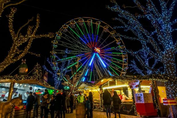 Ferris wheel lit up at night at the Luxembourg City Christmas market