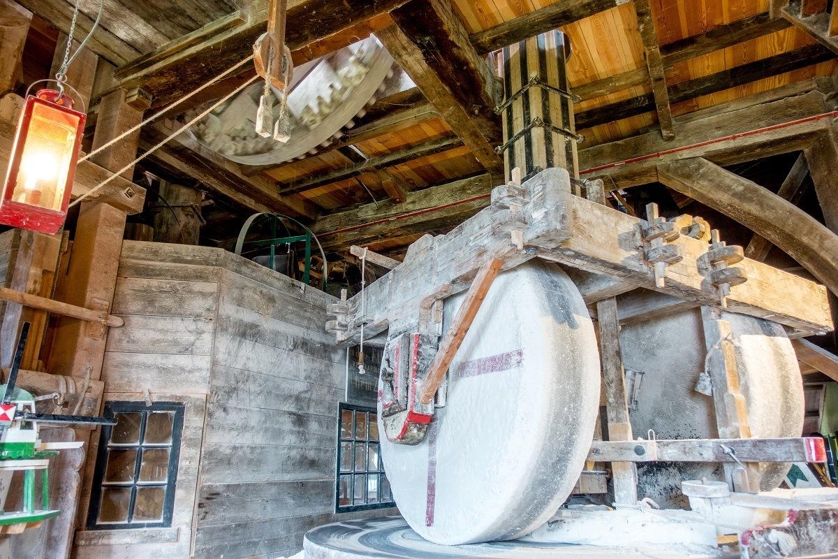 Wheels grinding chalk into powder inside De Kat windmill