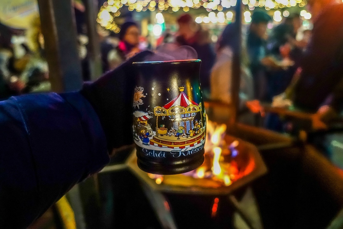 Mulled wine in a mug over an open fire