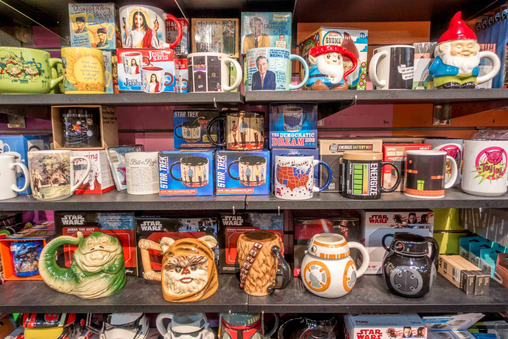 Star Wars-themed coffee mugs on a shelf at Toy Joy in Austin, Texas