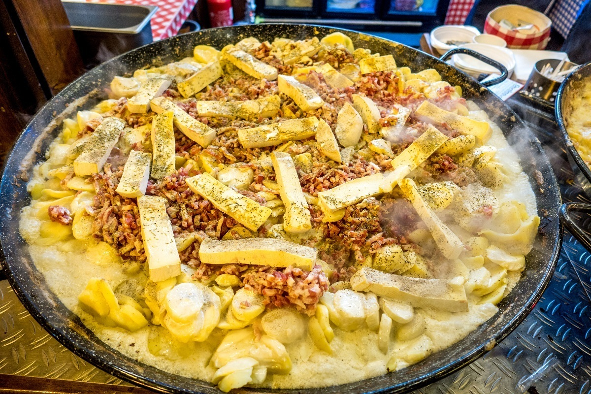 Pan of tartiflette, a mix of potatoes, onions, lardons, cheese, and white wine