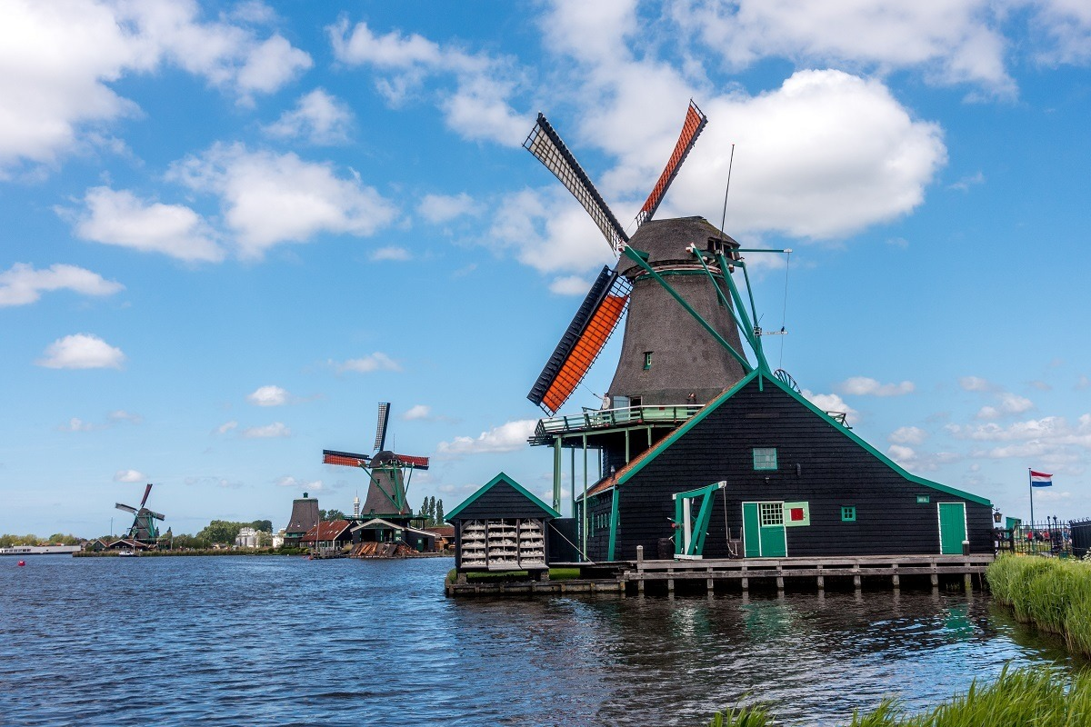 Windmills along the water