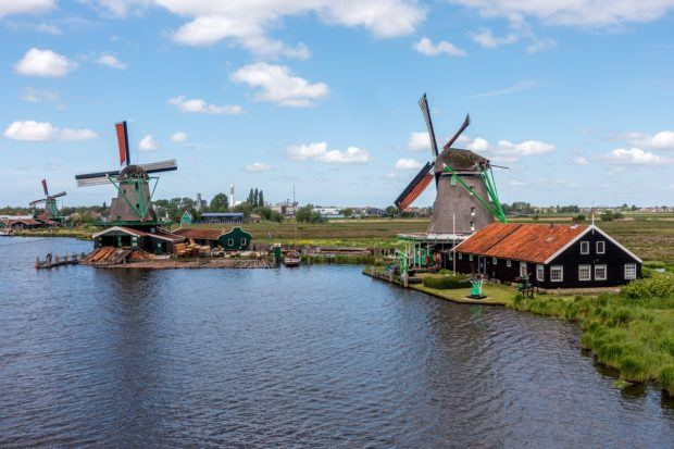 Three Zaanse Schans windmills on the Zaan River in the Netherlands