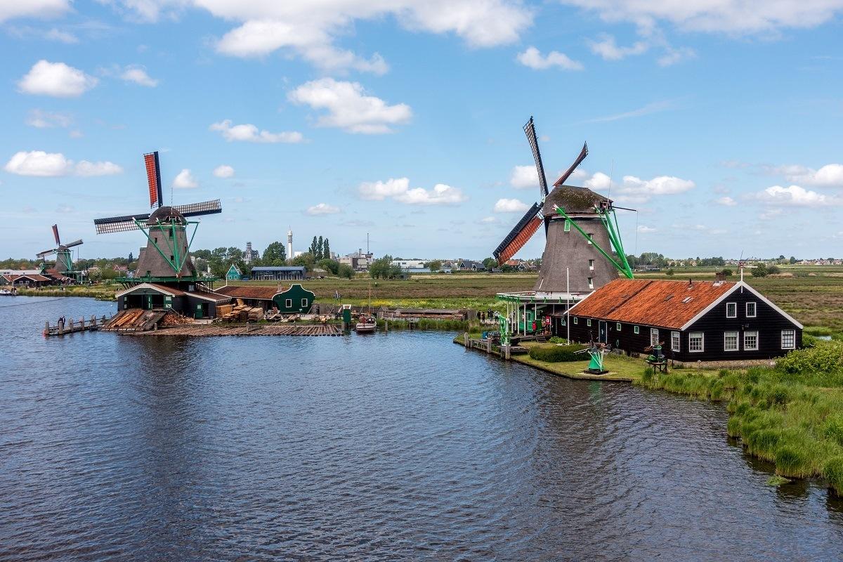 Three Zaanse Schans windmills on the Zaan River in the Netherlands