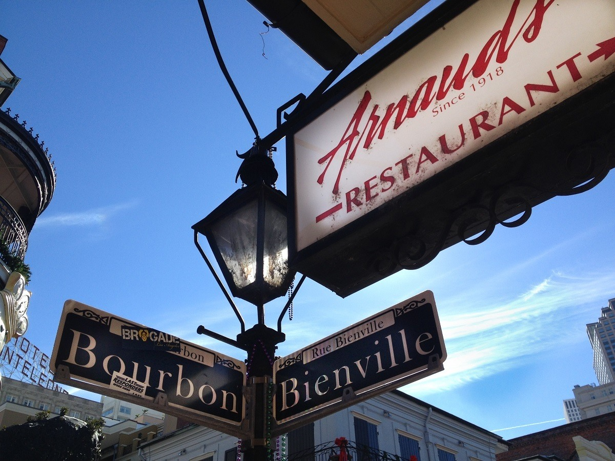 Sign for Arnaud's Restaurant next to street sign at the corner of Bourbon and Bienville