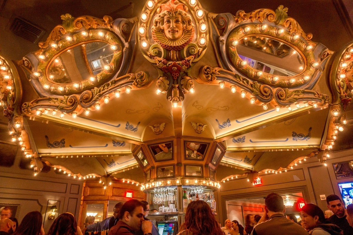 People sitting at the circular Carousel Bar in the Hotel Monteleone at night