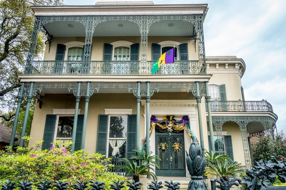 Mansion with wrought iron balcony and fencing in New Orleans